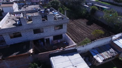 Carpenters Work on a New Section of a Small Ecuadorian Building Stock Footage