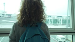 Woman Traveller Waiting for Flight at the Airport Stock Footage