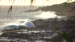 SLOW MOTION: Big strong wave crushing and spraying massively into rough shore Stock Footage
