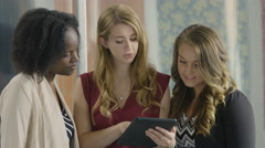 Young business women working on an ipad/tablet - stock footage