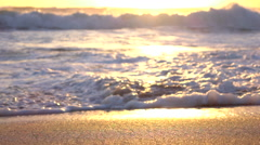 SLOW MOTION MACRO: Pretty sparkling ocean waving and washing golden sandy beach Stock Footage