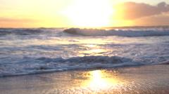 SLOW MOTION MACRO: Amazing ocean sliding, waving and washing golden sandy beach Stock Footage
