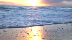 SLOW MOTION MACRO: Breath taking ocean sliding and washing golden sandy beach Stock Footage