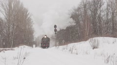 Steam train in Russian winter forest Stock Footage