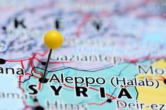 Aleppo pinned on a map of Syria - stock photo