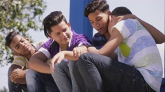 Group Of Teenagers Boys Supporting Comforting Friend Stock Footage