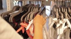 Girl Selecting Swimsuit or Bikini in Shopping Center Stock Footage