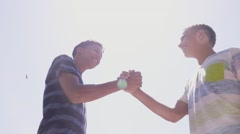 13-Slow Motion Hispanic And White Teenagers Shaking Hands - stock footage