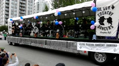 Silver diamond country dancers dancing on the truck - stock footage