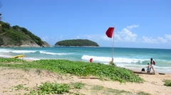 Traveller travel and relax on the Nai Harn beaches in Phuket, Thailand Stock Footage
