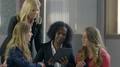 Business women using an ipad/computer tablet in a meeting Stock Footage