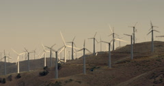 Tehachapi wind farm on hillside near mountains 4K Stock Footage