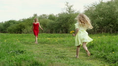 happy mother with girl on nature running toward each other - stock footage