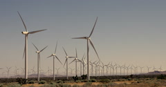 Back lit turbines at Tehachapi wind farm in Mojave Desert 4K - stock footage