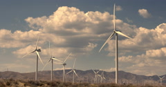 Large wind turbines and clouds at Tehachapi wind farm in Mojave Desert 4K Stock Footage