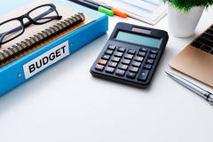 Financial and budget planning concept with calculator and laptop on white wor Stock Photos