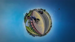 360Vr Video Tiny Planet Man Riding a Bicycle Taking Himself With Camera on a Stock Footage