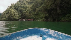 View from a small blue boat to Trunyan cemetery shore Stock Footage