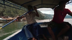 Two man rowing in a boat on Lake Batur on the way to Trunyan cemetery, editorial Stock Footage
