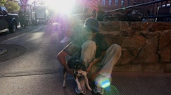 Homeless man holding a dog - stock footage