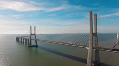 Beautiful modern bridge over the river aerial view Stock Footage