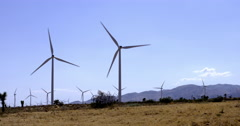 Silhouetted wind turbines near the Tehachapi Mountains 4K Stock Footage