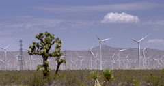 Wide view of wind turbines in desert near the Tehachapi Mountains 4K Stock Footage
