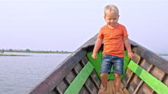 Toddler boy enjoys the boat trip - stock footage