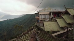 Kintamani village, houses on the edge of mountain side Stock Footage