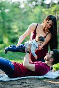 young family with a child on the nature - stock photo