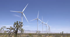 Wide view of turbines at wind farm near the Tehachapi Mountains 4K Stock Footage