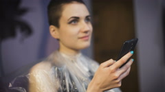 beauty, hairstyle and people concept - happy young woman with smartphone - stock footage