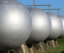 many giant gas pressure vessels for the storage of flammable natural gas in t - stock photo