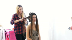 A young girl in the beauty salon make hairstyle Stock Footage