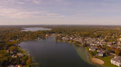 Keego Harbor Aerial over lake house neighborhoods Stock Footage