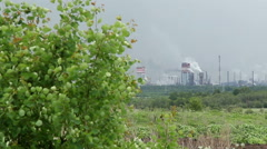 Green trees on the background of the industrial zone. Stock Footage