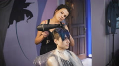 The girl with blue hair in a beauty salon Stock Footage
