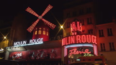 Moulin Rouge Red Building Boulevard de Clichy Avenue Nightclub Cabaret Show. - stock footage