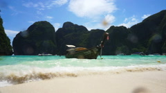 Paradise tropical islands, Krabi,Thailand boat at the white sand beach - stock footage