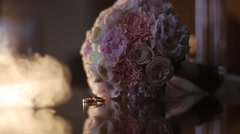 Wedding ring near a beautiful bouquet - stock footage