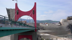 Pan down from the La Salve Bridge to the Guggenheim in Bilbao Stock Footage