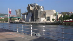 Residents walk by the Bilbao Guggenheim Stock Footage
