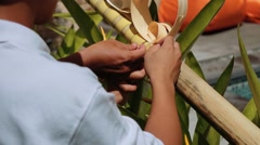 Balinese men decorating a penjor on Galungan Day Stock Footage