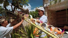 Two balinese men decorating a penjor on Galungan Day Stock Footage