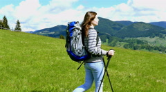 4K. Young girl tourist hiker with long hear in mountain hills. Steady shot - stock footage