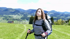 4K. Young attractive girl tourist  with long hear in mountain hills. Steady sho - stock footage