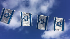 Slow motion Israel flags waving in the wind Stock Footage