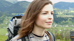 4K. Face of attractive girl tourist  in mountain hills. Steady shot Stock Footage