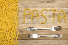 pasta text made of raw pasta - stock photo