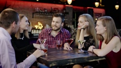 shy girl is telling something funny in the bar - stock footage